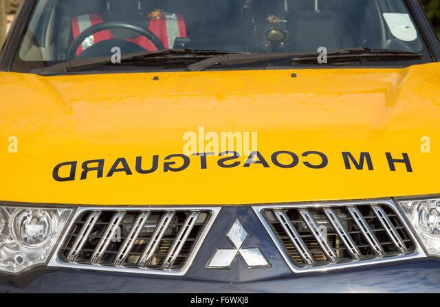 Coastguard sign with mirror writing on hood of vehicle, England, UK - Stock Image