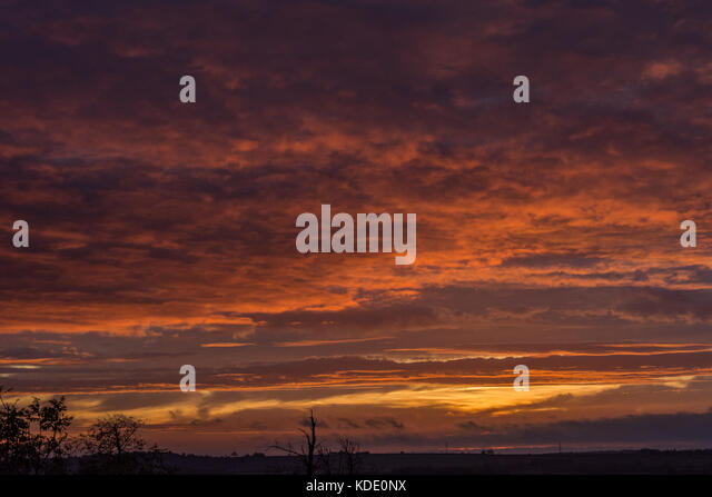 Melton Mowbrey, UK. 13th October, 2017. UK Weather: Red sky in the morning over the rural capital of England home - Stock Image