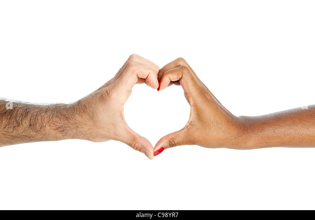 Mixed race couple making heart shape with hands - Stock Image