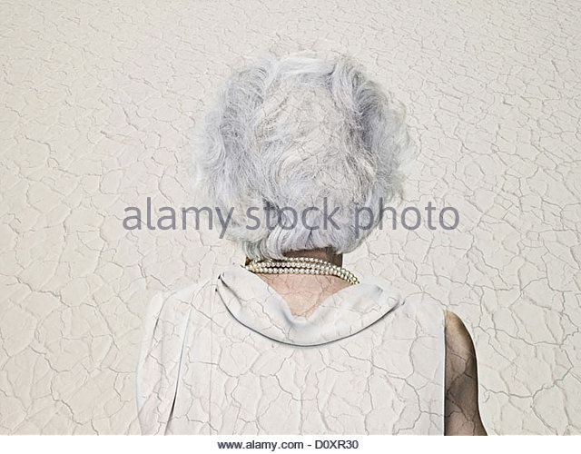 Senior woman double exposed with an arid landscape - Stock-Bilder