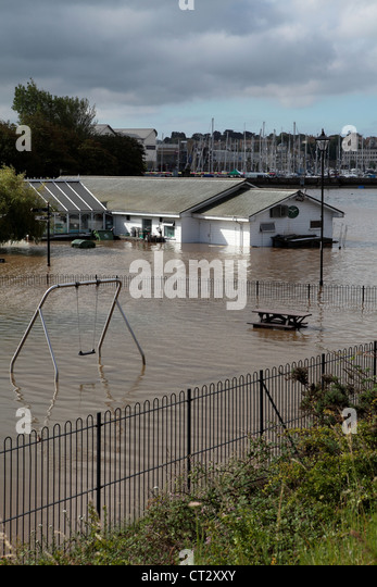 Local Dorset restarant and kids play area underwater after heavy rainfall in Wemymouth - Stock Image