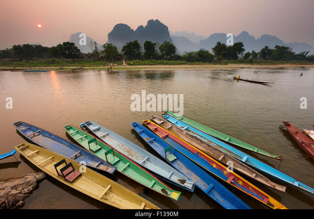 Canoes on the moored on the  Nam Song River at Vang Vieng, Laos, March 2009. - Stock Image