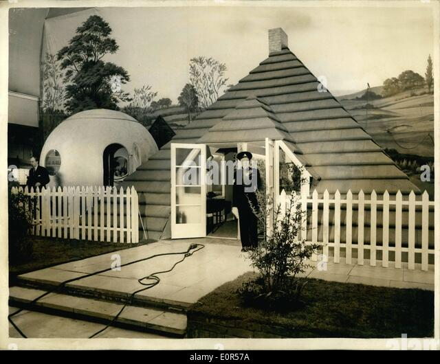 Mar. 03, 1958 - Ideal homes exhibition at Olympia. German built round house - and roof house: Photo shows two of - Stock-Bilder