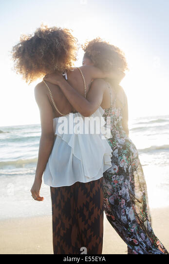 Two African-American female friends enjoying time in Venice Beach, California. - Stock Image