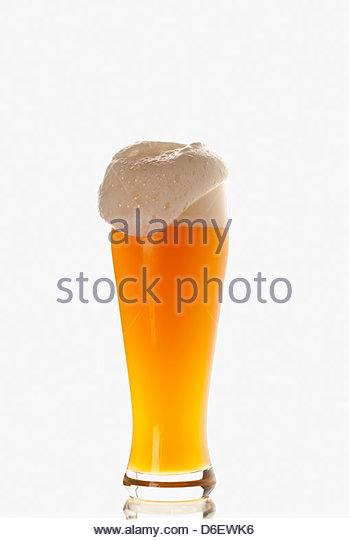 Overflowing glass Wheat beer Munich Germany - Stock Image