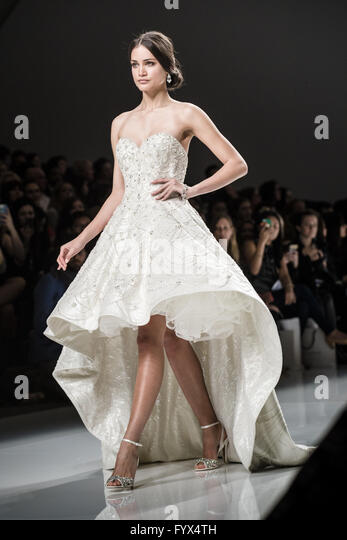 Barcelona, Catalonia, Spain. 28th Apr, 2016. A model walks the runway presenting a wedding dress of the Spring/Summer - Stock Image
