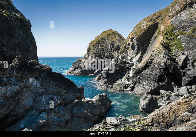 Cornwall coast - Rocks and headland at Mullion Cove, Lizard Peninsula, Cornwall, England, UK - Stock Image