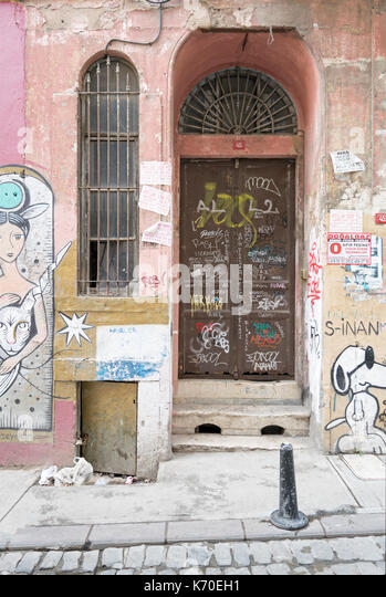 Istanbul, Turkey - April 18, 2017: Grunge metal door with random paints, Istanbul, Turkey - Stock Image