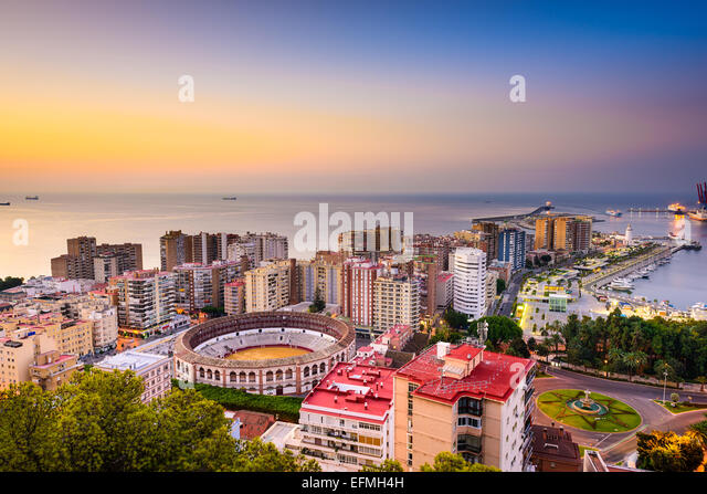 Malaga, Spain dawn skyline towards the Mediterranean Sea. - Stock Image