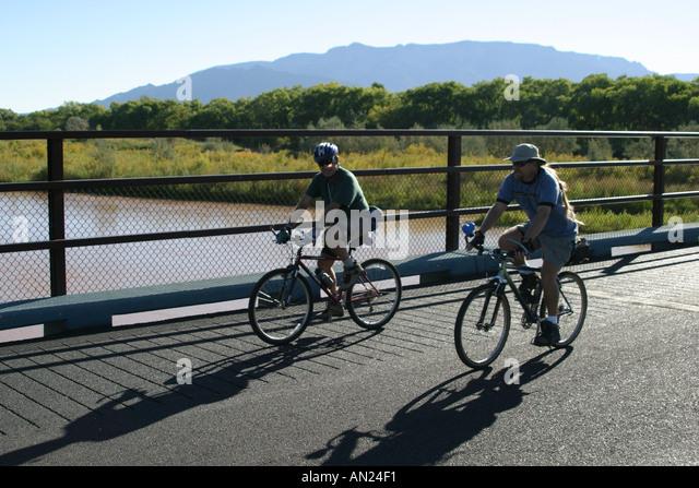 Albuquerque New Mexico Rio Grande State Park bikers Sandia Mountain T - Stock Image