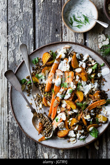 Carrot, lentils and beet salad with feta and herbed yogurt - Stock Image