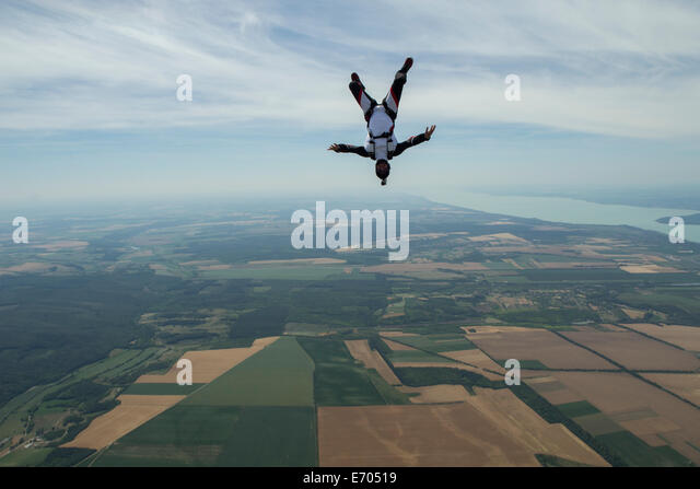 Male skydiver freeflying upside down above Siofok, Somogy, Hungary - Stock-Bilder