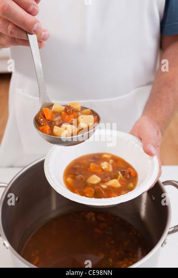 USA, Illinois, Metamora, Volunteer serving soup - Stock Image