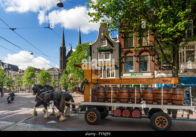 Carriage with barrels of Heinecken Beer,  Amsterdam, Netherlands - Stock Image