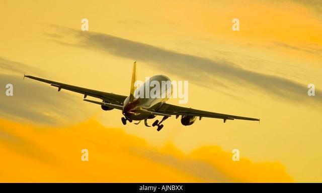 Commercial jet in flight - Stock Image