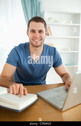 Student happy about research results - Stock Image