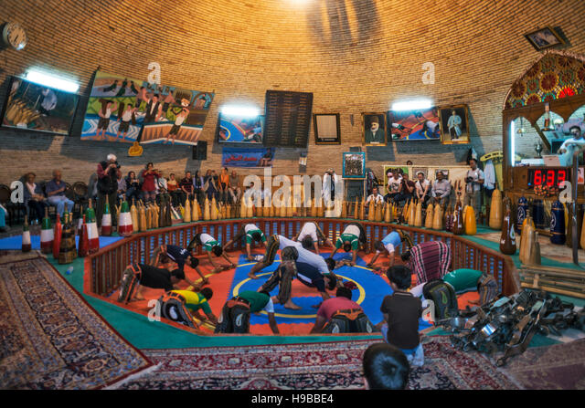 Iranians performing traditional sport Zorkhane Yazd Iran - Stock Image