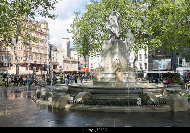 Tourists around the fountain in London's Leicester Square - Stock Image