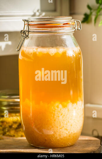 Homemade water Kefir and sauerkraut, prebiotics and probiotics that support gut health and improve the immune system. - Stock Image