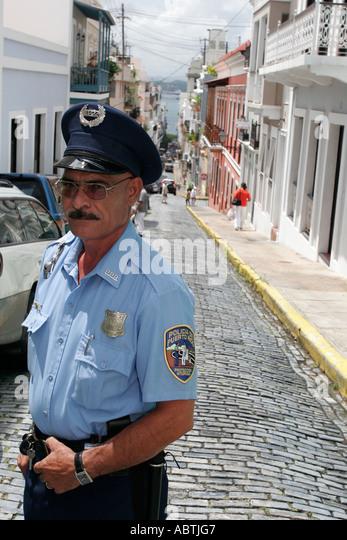 Puerto Rico Old San Juan Calle de la Cruz Hispanic male policeman - Stock Image