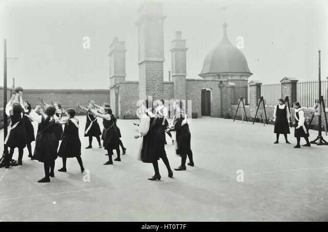 Playing netball, Myrdle Street Girls School, Stepney, London, 1908. Artist: Unknown. - Stock Image