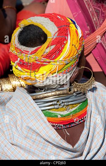 Head of Bonda tribeswoman wearing traditional beaded cap, Rayagader, Orissa, India - Stock Image