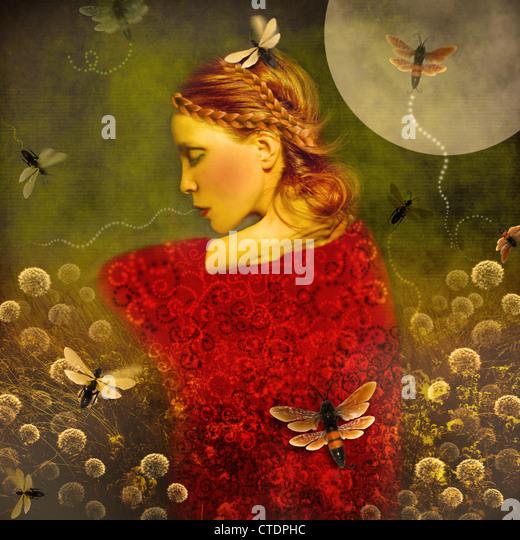 Magic Garden,young woman in garden with butterflies, - Stock Image
