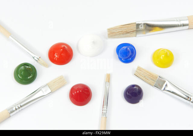 Acrylic colors and paint brushes on a white background - Stock Image