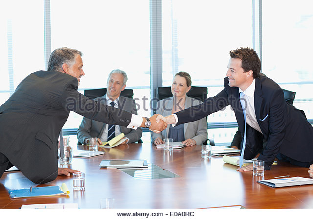 Business people meeting at table in conference room - Stock Image