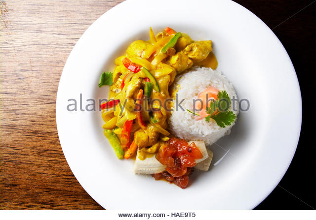Chicken curry and greens wrap with french fries - Stock Image