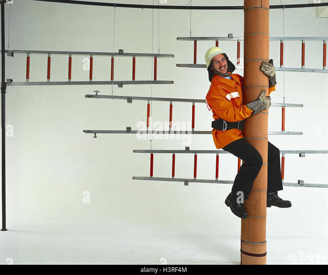 Entry, firefighter, pillar, hinunterrutschen, conductor, inside, man, fire brigade, occupation, working clothes, - Stock Image