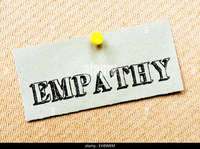 Recycled paper note pinned on cork board. Empathy Message. Concept Image - Stock Image