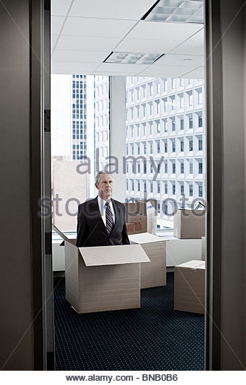 Businessman in cardboard box - Stock Image