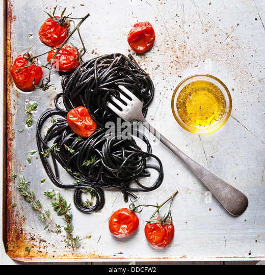 Black spaghetti with tomato sauce - Stock Image