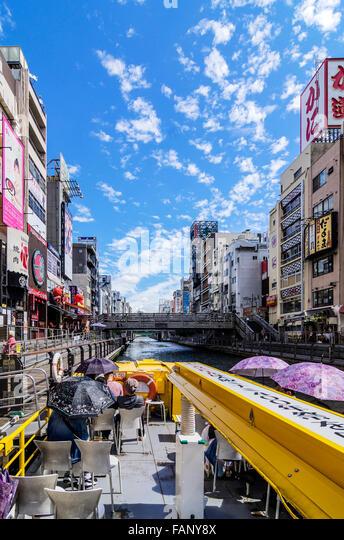 Boating, Dotonbori canal, Dotonbori district, Osaka, Japan - Stock Image