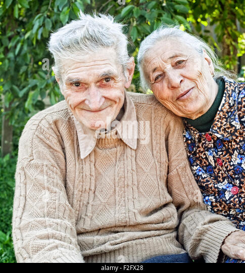 Happy and joyful old senior couple outdoor - Stock Image