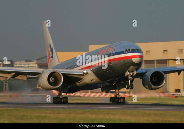 American Airlines Boeing 777-223/ER touching down at London Heathrow Airport - Stock Image