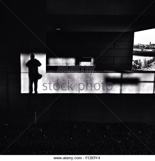 Shadow Of Man On Wall - Stock-Bilder