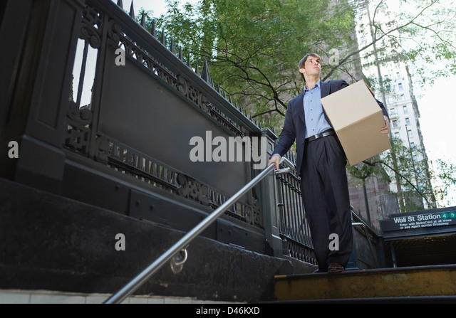 a trader having a last look at wall street before leaving following the market crash. - Stock Image