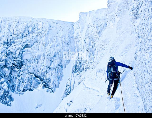 A mountaineer climbing the Eastern Traverse on Tower Ridge on Ben Nevis, near Fort William Scotland, UK - Stock Image