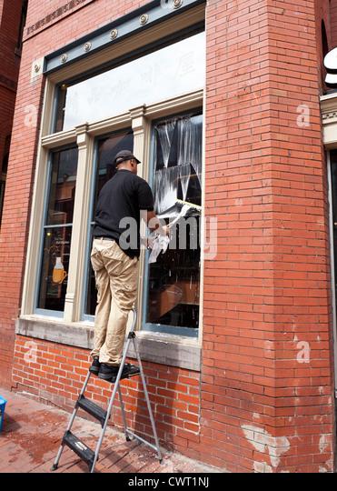 Window washer ladder stock photos window washer ladder stock images alamy for Wash exterior windows