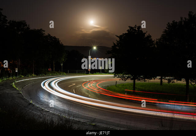 light trails from a car in a curve - Stock Image