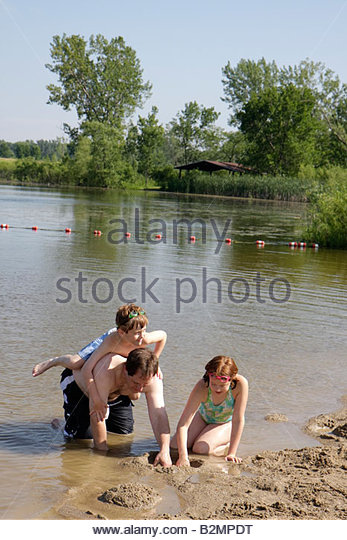 Wisconsin Kenosha Kansasville Richard Bong State Recreation Area Wolf Lake beach man boy girl parent father kid - Stock Image