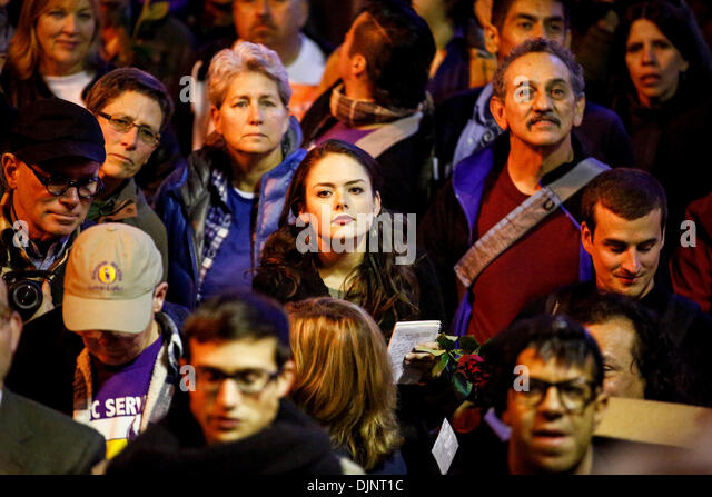San Francisco, California, USA. 27th Nov, 2013. People listen to speakers during a candlelight vigil that was held - Stock Image