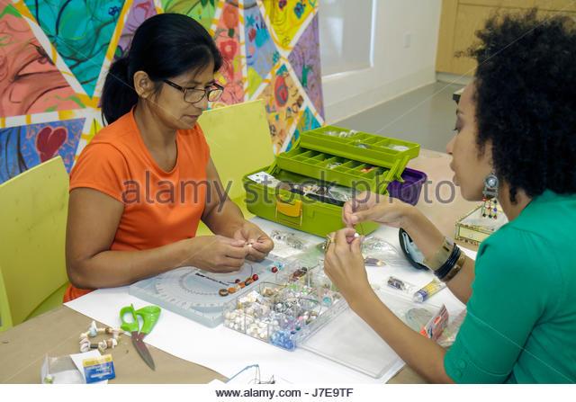Miami Florida Little Haiti Little Haiti Cultural Center jewelry workshop class Hispanic Black woman student teacher - Stock Image