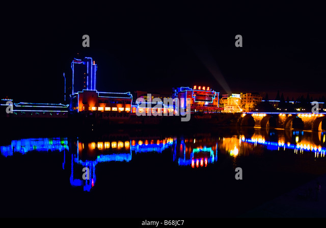 Buildings lit up at night, Tunxi District, Anhui Province, China - Stock Image