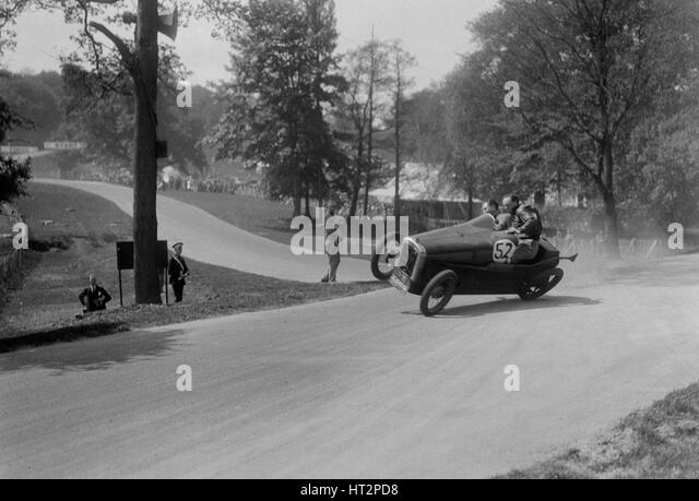 Austin 7 of B Sparrow about to crash, Donington Park Race Meeting, Leicestershire, 1933. Artist: Bill Brunell. - Stock Image
