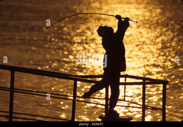 Russia former Soviet Union St. Petersburg Neva River boy fishing from landing - Stock Image