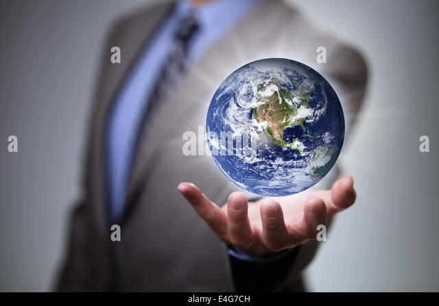 Businessman holding the world in his hands - Stock Image