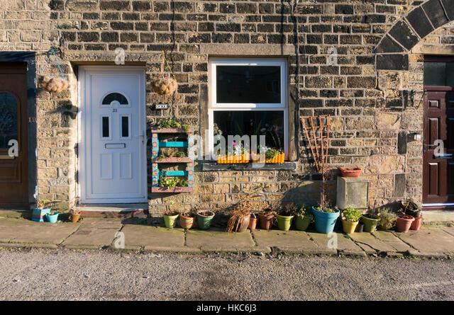 Plant pots outside stone cottage, Sowerby Bridge, West Yorkshire - Stock Image